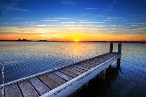 Setting sun behind the boat jetty, Lake Maquarie