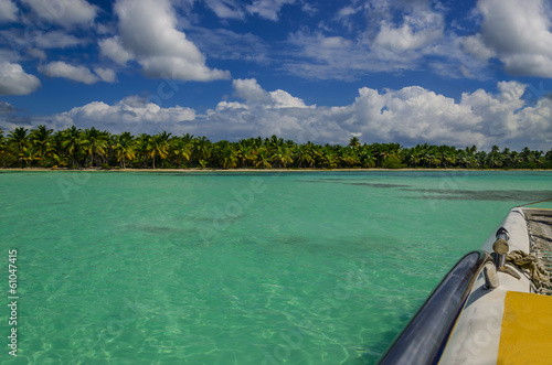 Catamaran Sails on Caribbean Sea among azure water and blue sky Poster