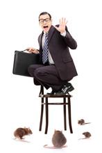 Terrified Businessman Standing...