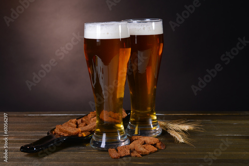Canvas Prints Beer / Cider Glasses of beer with snack on table on dark background