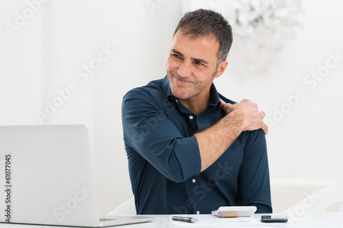 Fotografia  Businessman Suffering From Shoulder Pain