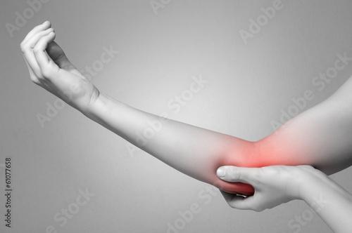 Fotografía  Woman with elbow pain