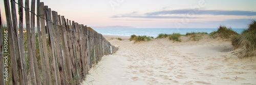 Fototapeta Panorama landscape of sand dunes system on beach at sunrise obraz