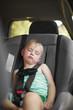 Little girl sleeping in car seat.