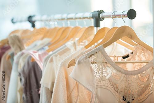Obraz Dresses on a wooden hangers - fototapety do salonu