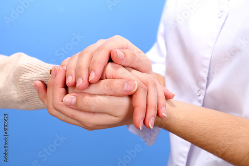 Fototapety, obrazy: Medical doctor holding hand of patient, on light background