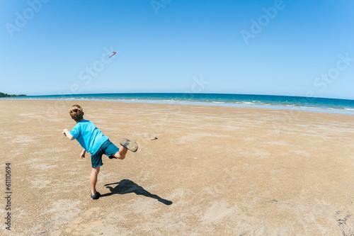 Boy Throwing Boomerang Beach Blue Canvas Print
