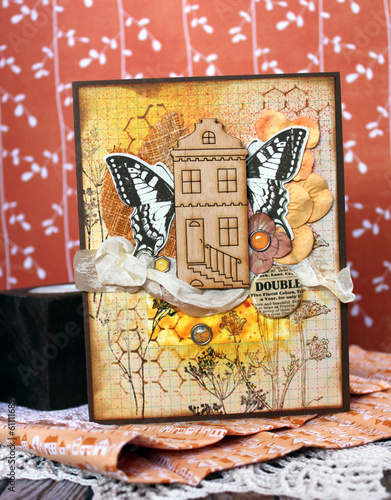 Tuinposter Sprookjeswereld Orange handmade card with a wooden house and a butterfly