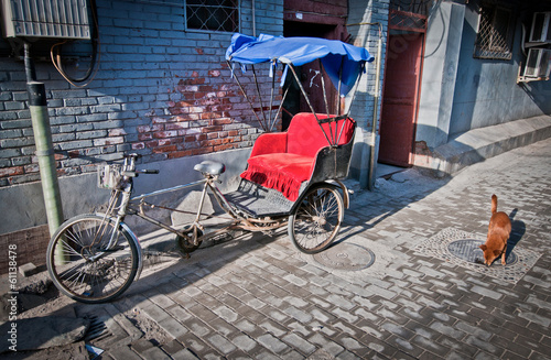 Fényképezés  cycle rickshaw on narrow alley in hutong area in Beijing, China