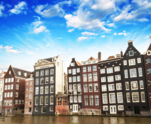 Photo  Amsterdam. Beautiful view of classic buildings with colourful sk