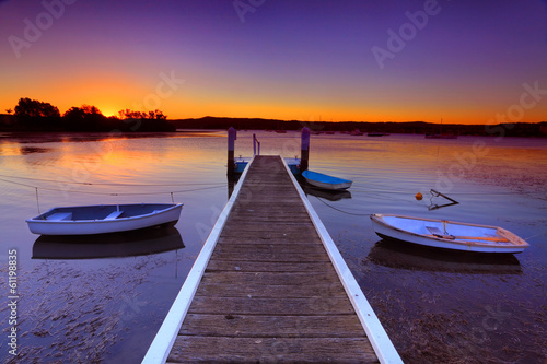 Poster Violet Sunset moorings and boat jetty in a little cove Australia