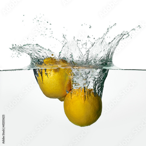 Fresh Lemons Splash in Water Isolated on White Background