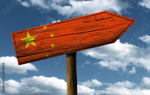 Foto  Chinese flag wooden sign with a beautiful sky on background