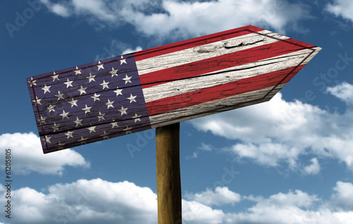 Foto op Canvas Australië USA flag wooden sign with a beautiful sky on background
