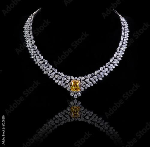Foto Diamond necklace shot against a black background