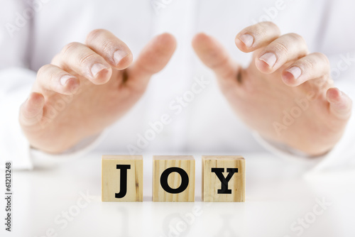 Fotografie, Tablou  Mans hands cupped over the word Joy