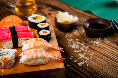Poster Sushi bar Wonderful sushi set, oriental theme on the old wooden table