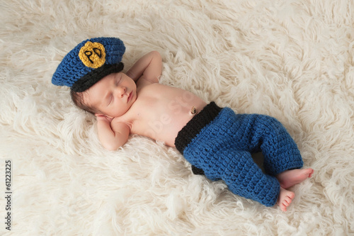 Fotografie, Obraz  Newborn Baby Boy in Policeman's Uniform