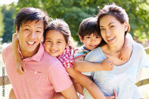 Fotografia  Portrait Of Asian Family Enjoying Walk In Summer Countryside