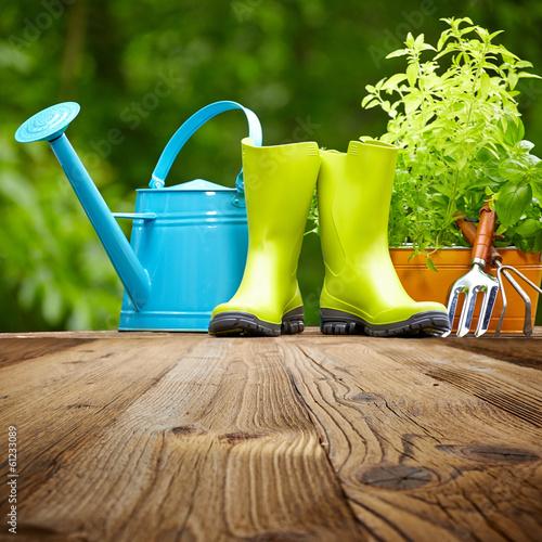 Fototapeta Outdoor gardening tools  on old wood table obraz