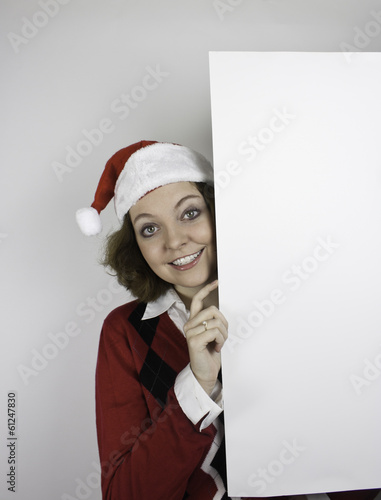 b8a2e4ba3ca06 Pretty young woman wearing red and black sweater and Santa hat - Buy ...