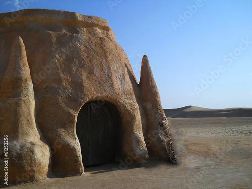 Photo  Stone castle in the desert. Dunes