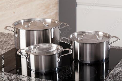 Fotografía  New cookware set on induction hob