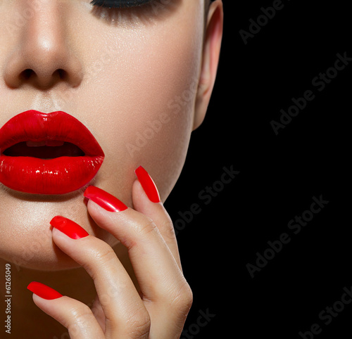 Fotografie, Obraz  Red Sexy Lips and Nails closeup. Manicure and Makeup
