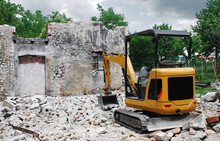 Compact Excavator On Small Bui...