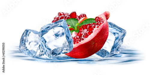 Pomegranate. Fruit with ice isolated on white background