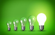canvas print picture - Row of light bulbs.Idea concept on green background.