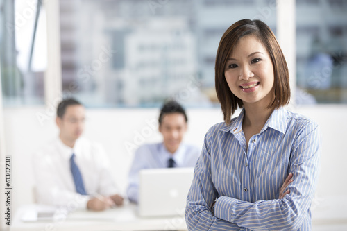 Fotografia  Asian Businesswoman leading a business team