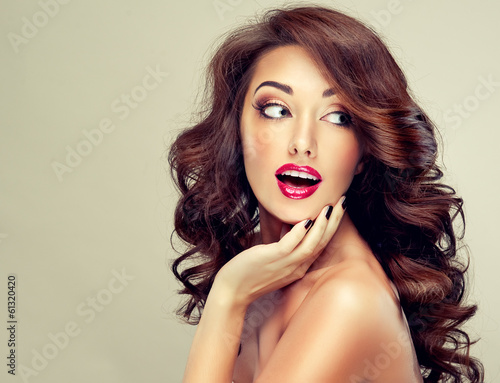Fotografie, Obraz  Model with beautiful hairSurprised girl with wavy hair