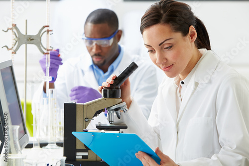 Fotografija  Technicians Carrying Out Research In Laboratory