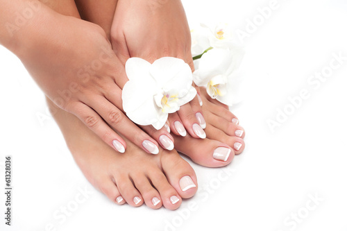 Wall Murals Pedicure Beautiful woman's hands and legs