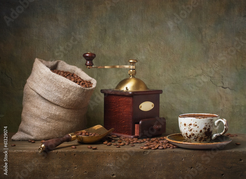 Fototapeta Still life with cup of coffee and grinder obraz