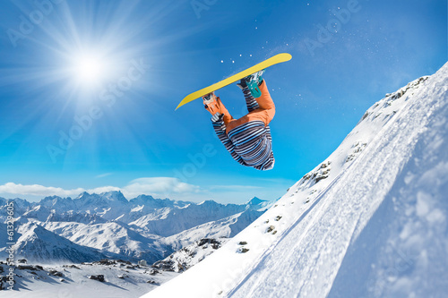 Extreme snowboarder jumping high in the air