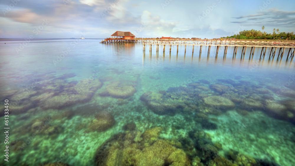 Fototapeta Long pier dan beautiful coral at Mabul Island