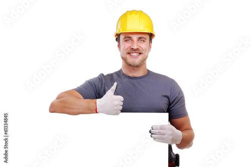 carpenter holding the blank board