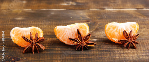 Ripe sweet tangerine, on wooden background,  close-up