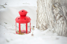Red Lantern With Lighted Candle In The Snow