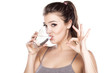 Leinwanddruck Bild - beautiful woman drinks water from a glass and shows delicious