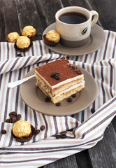 Fototapeta Portion of delicious tiramisu cake
