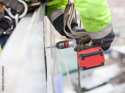 Closeup of industrial climber with screwdriver Canvas Print