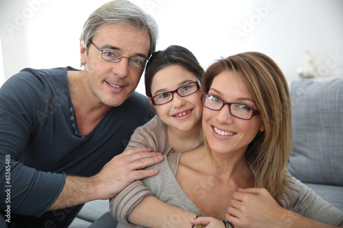 Photographie Portrait of family of 3 people wearing eyeglasses