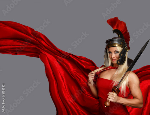 Blonde in a centurtion helmet and a red dress Wallpaper Mural