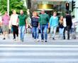 Motion blurred crowd crossing street