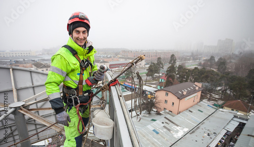 Fotografie, Obraz  Industrial climber on a metal construction