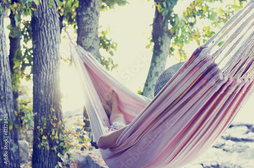 Poster  Person relaxing in a hammock, with retro filter effect