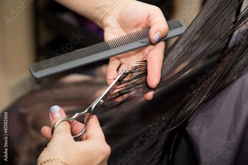 Women's haircut scissors at salon